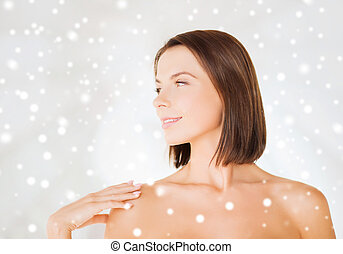 beautiful woman touching her shoulders - beauty, spa, health...