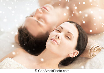 happy couple in spa - beauty, health, holidays, people and...