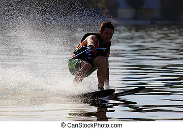 athlete waterskiing - athlete touches the water when riding...