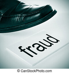 fraud - a man foot wearing a black shoe stepping in a...