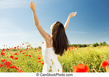 young woman on poppy field - happiness, nature, summer,...