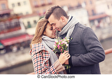 Romantic couple with flowers on a date
