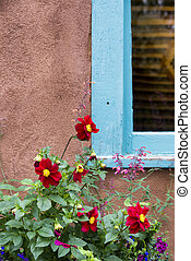 Red Flowers Adorning a New Mexico Window - Bright red...