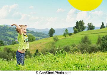 Smiling boy bouncing the balloon