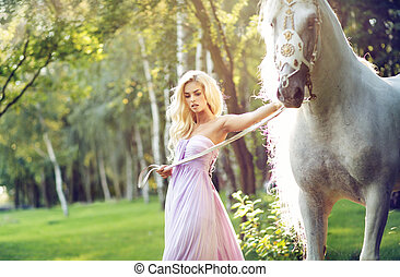 Blond nymph walking with a horse - Blond nymph walking with...