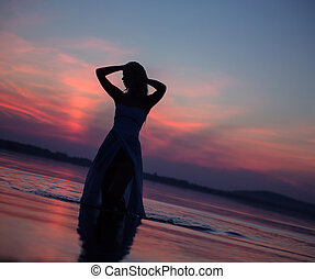Lady's silhouette in the water