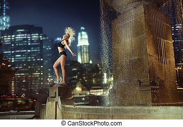 Athlete dancing on the fountain