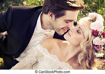 Romantic scene of kissing marriage couple