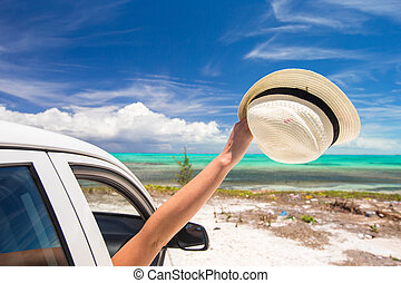 Close up of hat on white car at caribbean island - Yellow...