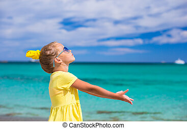 Adorable little girl at white beach during summer vacation -...