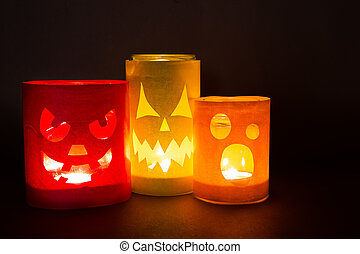 Funny jack-o-lanterns on a dark background