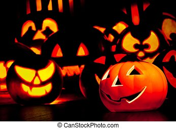 Halloween night background with scary pumpkins in background