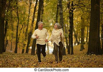 Mature couple walking - Mature couple walking in the autumn...