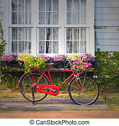 Red vintage bicycle with flowers
