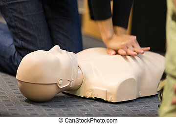 First aid CPR seminar. - A group of adult education students...