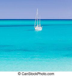Pelosa beach, Sardinia, Italy - White sail boat at the...
