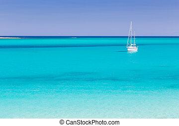 Pelosa beach, Sardinia, Italy. - White sail boat at the...
