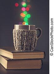 Hot beverage in a brown mug and bokeh