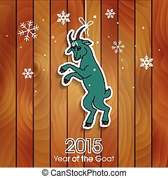 Green goat decoration on a wooden background. New Year...