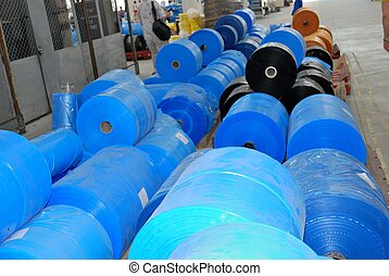 polyethylene in wharehouse - many big rolls of blue...