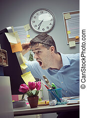 Businessman reading shocking news online - Shocked...