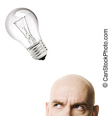 idea - light bulb and man isolated on white background,...