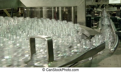 empty bottles on a rotating conveyo