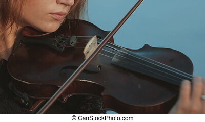 Girl emotionally plays the violin