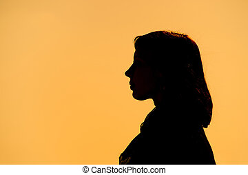 A black silhouette of a woman - Contours of a young girl on...