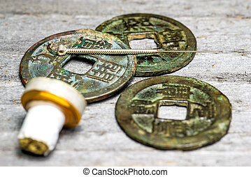 acupuncture needle on chinese coins - acupuncture needle on...