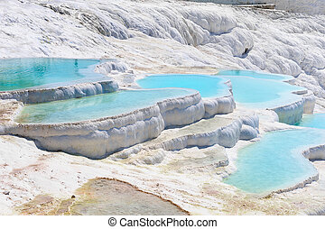Travertine pools and terraces in Pamukkale, Turkey - Blue...
