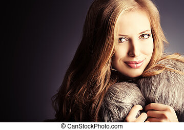 warm clothing - Portrait of a beautiful woman in a jacket...