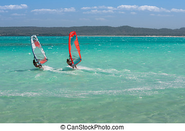 Windsurfers - Couple of windsurfers in the vastness of the...