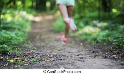 Woman running into the forest
