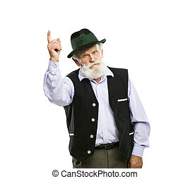 Old bavarian man in hat pointing upwards isolated - Portrait...