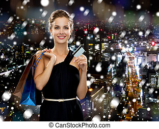 smiling woman with shopping bags - shopping, sale,...