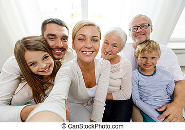 happy family making selfie at home - family, happiness,...