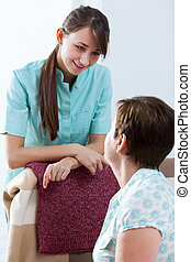 Nurse during home visit - Portrait of young nurse during...