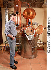 Man in front of distillery - copper