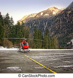 Red helicopter landed at swiss heliport at Jungfrau region...