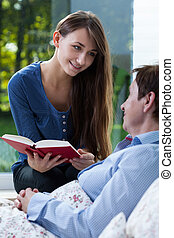 Young volunteer reading book - Young volunteer reading ill...