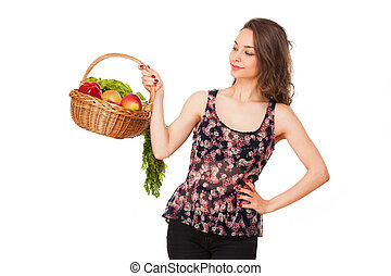 Basket of healthy goodies. - Gorgeous young brunette woman...