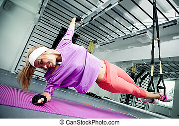 Functional training - Young woman streching muscles making...