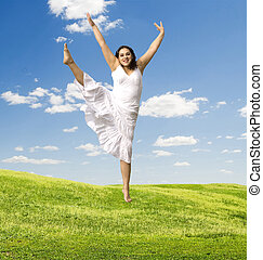 jumping woman - jumping happy woman against nature...