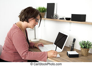 Working at Home - Woman working in a cozy workspace at home