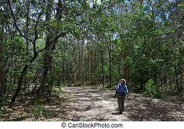 Mature woman birdwatching in Coombabah Lake Conservation...