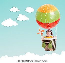 cute kid on hot air balloon in the blue sky - cheerful kid...