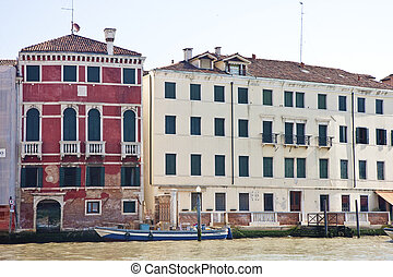 Red and Yellow Buildings Along Canal - Old buildings along...