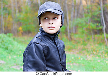 chil boy pensive thoughtful look forest fall