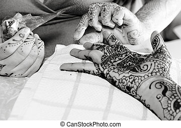 Putting On Henna - Henna is applied to the hands of a Hindu...